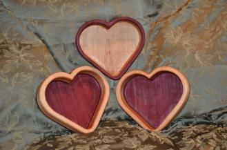 Same blanks were used for all three: 8/4 Hard Maple with 4/4 Purpleheart. The one on top shows more of the passionate color when filled with candy. Your preference?