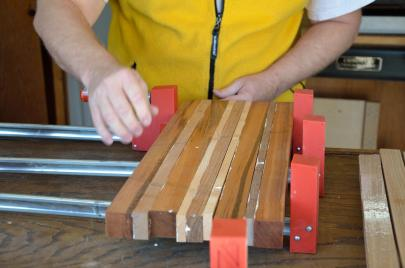 Carefully begin clamping the boards together.