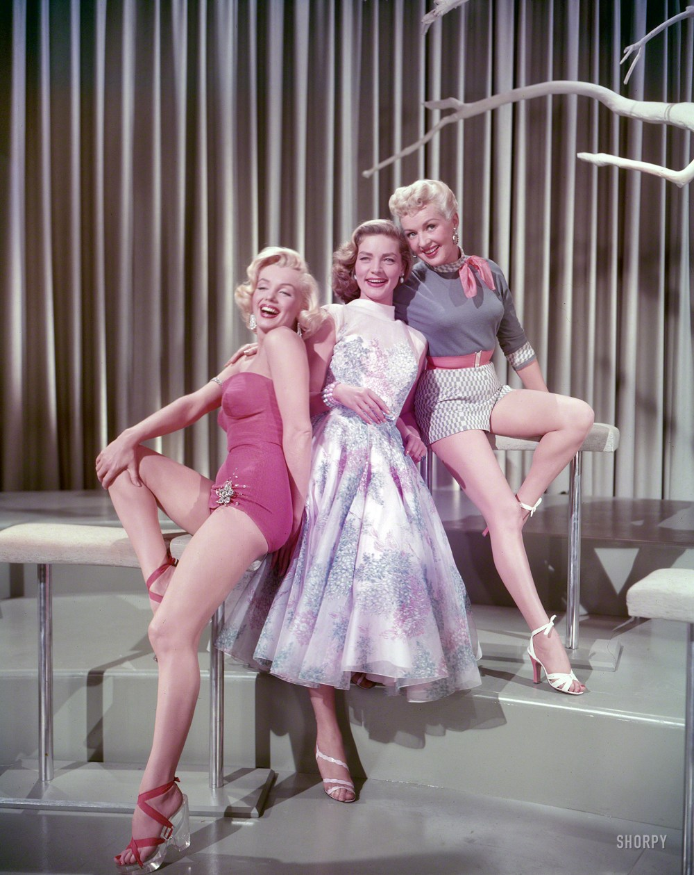 "Publicity shot of Marilyn Monroe, Lauren Bacall and Betty Grable in the 1953 release of 20th Century Fox's ""How To Marry A Millionaire."" Courtesy of Shorpy Historical Photos."