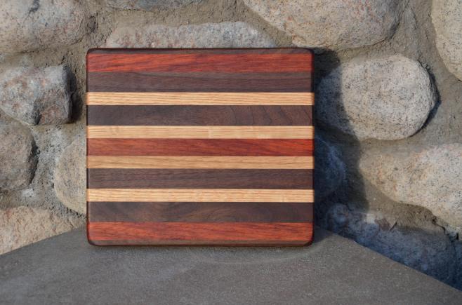 # 10 Cheese Board, $30. Walnut, Padauk, Hard Maple, Red Oak.