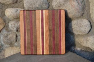 # 9 Cheese Board, $35. Red Oak, Purpleheart, Walnut, Hard Maple.