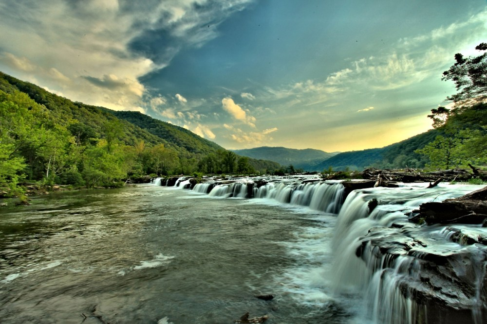 A rugged, whitewater river flowing northward through deep canyons, the New River in West Virginia is among the oldest rivers on the continent. The park encompasses over 70,000 acres of land along the New River, is rich in cultural and natural history, and offers an abundance of scenic and recreational opportunities. Photo: Adam Jewell. Tweeted by the US Department of the Interior, 2/11/14.