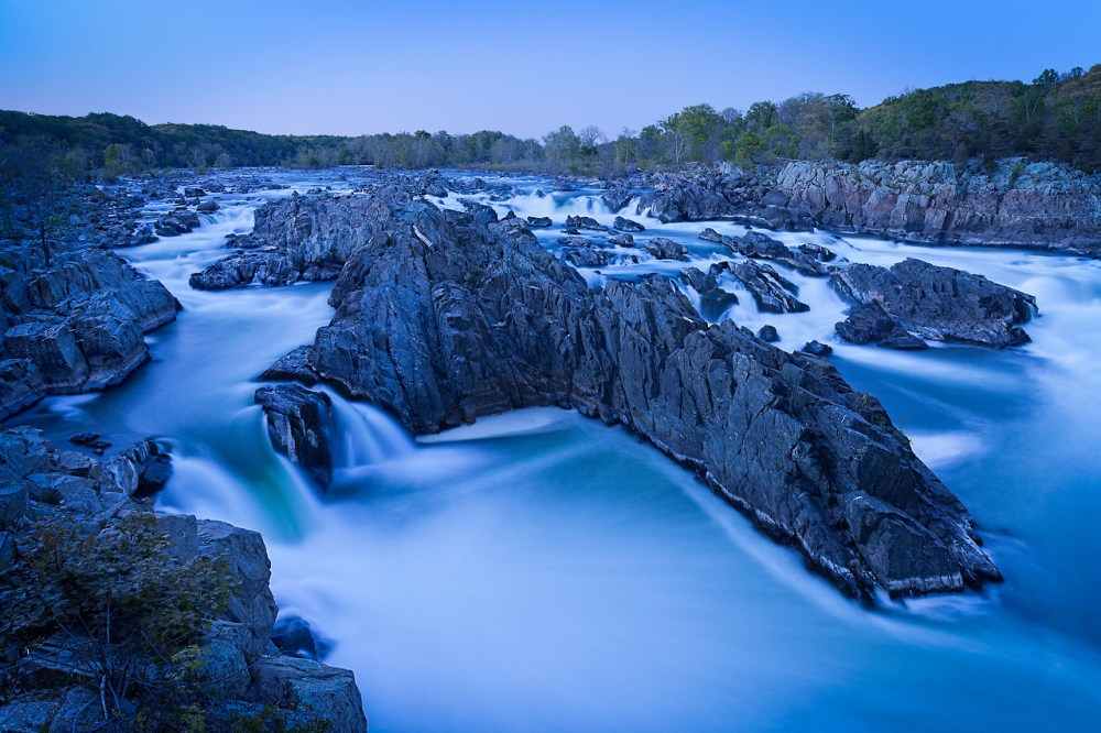 "Chris Tennant took this amazing photo from Great Falls Park in Virginia. Here's what he had to say about this photo. ""These amazing falls be tricky to shoot. With so much exposed sky and without a spectacular light show you can end up with a very flat image. Lacking any clouds, I patiently waited for the ""blue hour"", when the tones in the sky evened out."""