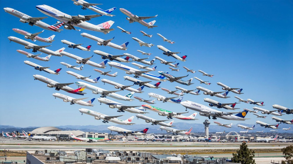 "(Photo courtesy of Michael Kelley) ""I had no intention of it being this crazy thing,"" says Kelley about his image, which went viral after he posted it Monday on Reddit's aviation subcategory. ""It just got shared over and over."" The image is a compilation of 75 different pictures that Kelley made during the course of a eight-hour shoot on Sunday, March 31. He didn't include every single plane that he took pictures of taking off, omitting some kinds of planes that showed up over and over again. The image represents take offs from two different runways at LAX. ""I was up until four in the morning on Sunday night and then woke up on Monday morning and continued to work on it,"" says Kelley, spending about eight hours total in post processing. ""The final image was 75 layers in Photoshop... so it was pretty significant in terms of staring at the screen with the pen tool."" He's still not quite sure why the image went viral. ""It makes people happy, it's colorful... it's interesting,"" ponders Kelly. ""It's a pretty simple thing to digest."" For all the complexity of the process, the picture clearly and simply tells the story of a day on the runway. Michael Kelley is a Los Angeles based photographer specializing in architecture. Prints of this image and others are available here."