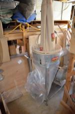 Here's the dust collector with the new bottom plastic bag mounted, and the upper felt bag fully collapsed. Ready to begin again.