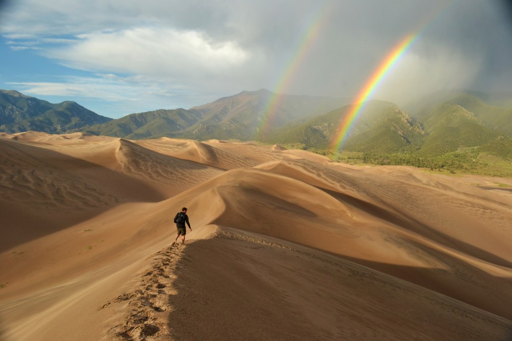 The tallest dunes in North America are the centerpiece in a diverse landscape of grasslands, wetlands, conifer and aspen forests, alpine lakes, and tundra of Great Sand Dunes National Park in Colorado. Experience this diversity through hiking, sand sledding, splashing in Medano Creek, wildlife watching, and more!  Photo: Eric Magayne