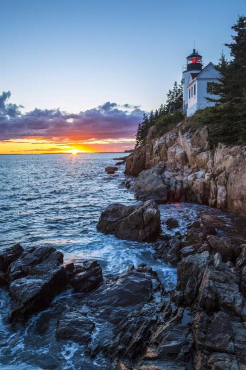 Sunset over Maine's Bass Harbor Head Lighthouse in the Acadia National Park.