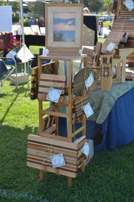 The front of the wood display is a 4' tower, with multi-levels of both cheese boards and cutting boards. The top allows is for a featured product.
