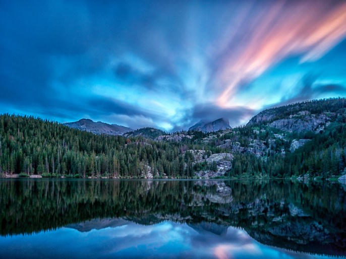 Bear Lake, just after sunset, with Hallett Peak in the background, just beginning to be enveloped by clouds in Rocky Mountain National Park. Photo: Glenn Nelson. Posted on Tumblr by the US Department of the Interior 6/4/14.