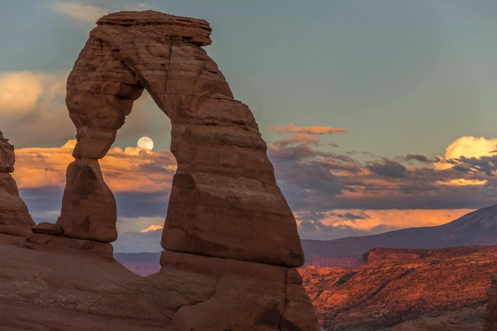 The so-called Super Moon of 7/12/14 rises at Delicate Arch, Arches National Park. Posted by the US Department of the Interior on Tumblr, 7/13/14.