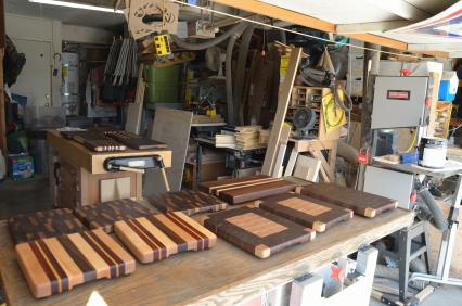 """The latest batch of cutting boards are curing ... they weep oil for a couple of days after they are """"finished,"""" and that process must be done in a shop with no sawdust flying. So, no more cleaning until next weekend."""