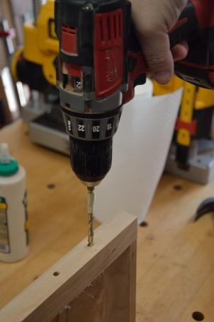 The dowel holes are deep (up to the masking tape marker) so the cross-grain, glued-in dowel will add strength to the end/side glue joint.