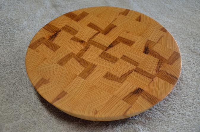 """Hickory end grain board. 14"""" diameter x 1-1/4"""" thick. 20 degree cant on the edge."""