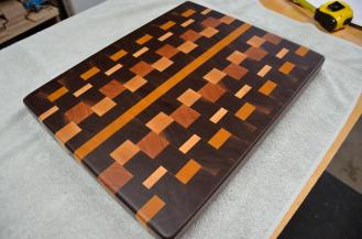 "# 68 Cutting Board, $150. Black Walnut, Yellowheart, Cherry and Hard Maple. 18-3/8"" x 14-1/2"" x 1-1/2"". End grain."
