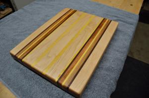 "Commissioned piece. 16-1/4"" x 12-3/4"" x 1-1/2"". Hard Maple, Black Walnut, Cherry and Yellowheart. Edge Grain."
