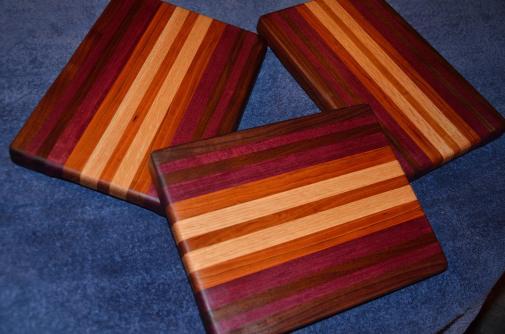 "Edge grain. Walnut, purpleheart, cherry and maple. 11"" x 9"" x 1""."