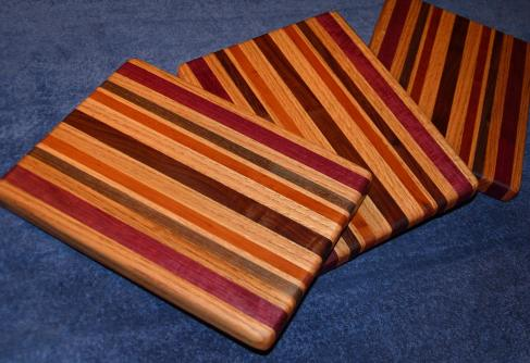"Edge grain. 11"" x 9"" x 1"". Oak, purpleheart, walnut and cherry."