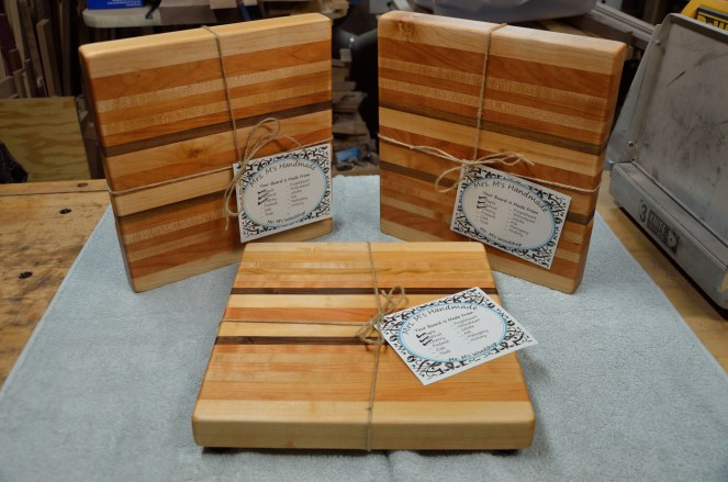 "Three boards, each 12"" x 11-1/2"" x 1-1/2"". Hard maple, cherry and black walnut edge grain."