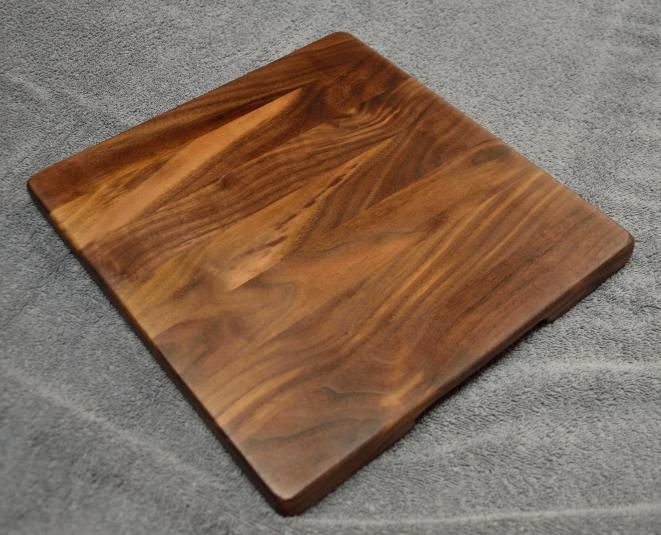 "Black Walnut edge grain. 12"" x 12"" x 1""."