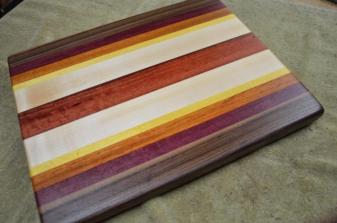 "Black Walnut, Purpleheart, Jatoba, Yellowheart, Hard Maple and Jarrah edge grain. 13"" x 16"" x 1-1/8""."