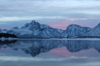 "A stunning sunset over Grand Teton National Park in Wyoming. Christina Adele Warburg took this photo of Mount Moran and Jackson Lake from the park's Colter Bay District a few weeks ago after a recent snow. ""I had to snowshoe to the edge of the lake for the sunset. The effort was definitely worth the reward,"" says Christina. Posted on Tumblr by the US Department of the Interior, 12/1/14."