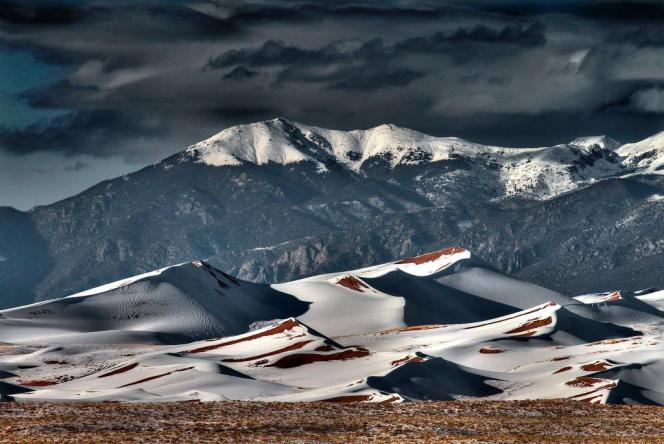 Dark clouds & a blanket of snow created this dramatic shot at Great Sand Dunes National Park. Photo by David Paul Davie. Tweeted by the US Department of the Interior, 1/29/15.