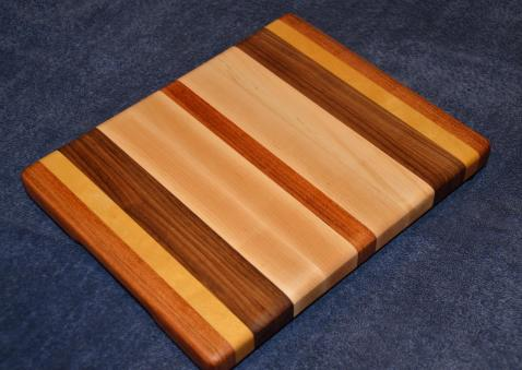 "Edge grain cutting board. Jatoba, Yellowheart, Black Walnut and Hard Maple. 10"" x 12"" x 1""."