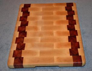 "Cutting Board # 15 - 014. Hard Maple and Jarrah, with just a spectacular grain pattern. End grain, of course. 12"" x 16"" x 1-1/4""."