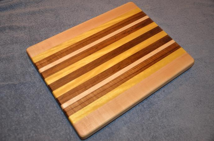 "Cutting Board # 15 - 015. And the hits keep coming. The photo just doesn't do justice to the florescence of this Yellowheart. Fabulous grain on this one. Hard Maple, Yellowheart and African Teak. 12"" x 16"" x 1-1/2""."