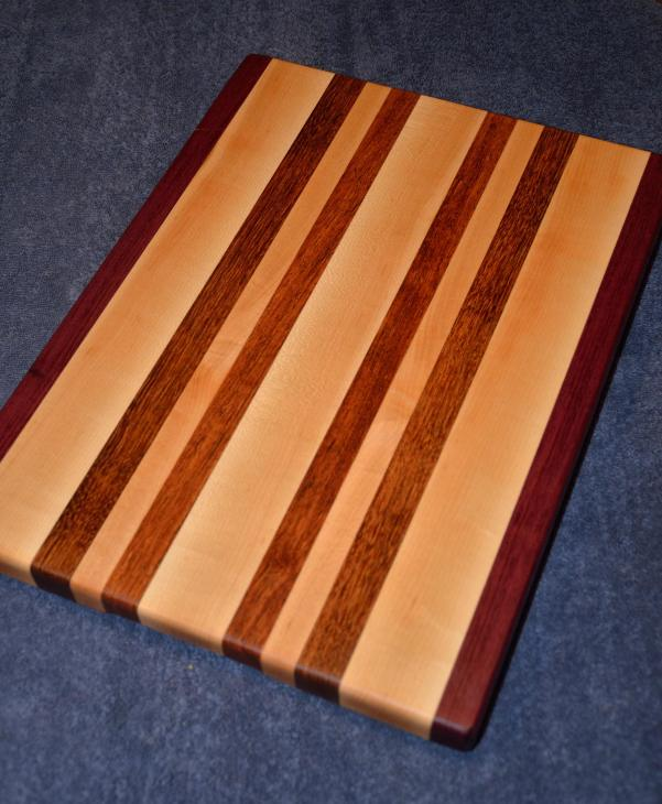 "Purpleheart, Hard Maple and Jatoba edge grain cutting board. 12"" x 16"" x 1-1/4""."