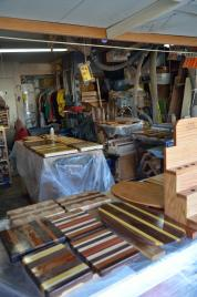 I often end up using every flat surface in the shop, and wish I had more. Everything gets draped in plastic, and boards are floating above the plastic on scrap lumber.