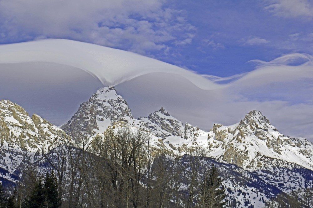 This rare display of lenticular clouds over Grand Teton National Park in Wyoming last week captivated park visitors. Lenticular (lens-shaped) clouds occur when stable, moist air flows over a mountain, creating a series of large-scale standing waves on the downwind side. Photo by Jackie Skaggs, National Park Service. Posted on Tumblr by the US Department of the Interior, 2/18/15.