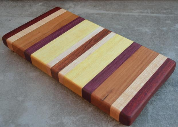 "Jatoba, Hard Maple, Cherry, Black Walnut and Yellowheart edge grain board. 13"" x 6"" x 1-1/4""."