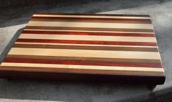 "Cutting Board # 15 - 022. 12"" x 16"" x 1-1/4"". Black Walnut, Hard Maple and Padauk."