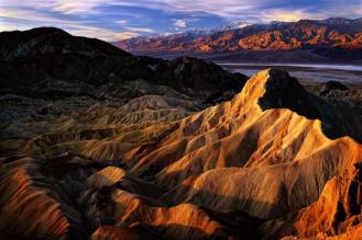 A view that will stop you in your tracks. Sunrise from Zabriskie Point in Death Valley National Park. Located in the park's Furnace Creek Area, Zabriskie Point provides spectacular views of the park's wildly eroded and vibrantly colored badlands with the flat salt plains and the Grapevine Mountains visible in the distance. Photo by Steve Perry. Tweeted by the US Department of the Interior, 3/11/15.