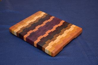 "Small Board # 15 - 035. Cherry, Yellowheart, Hard Maple, Jatoba, Purpleheart, Padauk and Honey Locust End Grain. 13"" x 11"" x 1-1/4""."