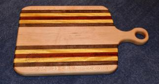 "Sous Chef # 15 - 13. Hard Maple, Yellowheart, Padauk and Black Walnut. 9"" x 15"" x 1""."