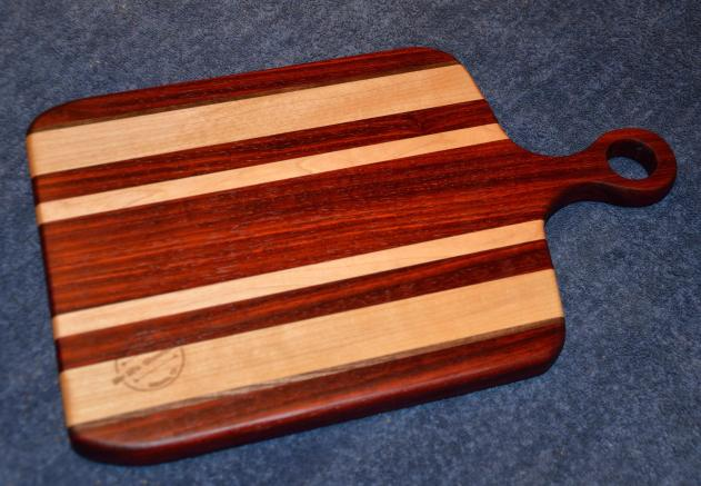 "Sous Chef # 15 - 14. Hard Maple, Padauk and Black Walnut. 9"" x 15"" x 1""."