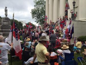 Protestors in Birmingham, AL, gathered on the state capitol's steps after the Alabama governor removed the Confederate Battle Flag from the capitol's grounds.