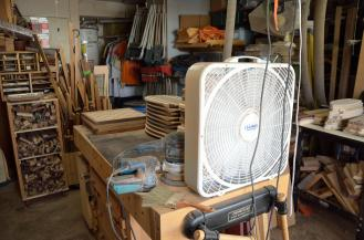 "Here's the idea: a 20"" box fan on the end of the workbench ..."