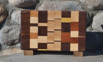 "Cheese Board # 15 - 024. Black Walnut, Hard Maple, Cherry & Yellowheart. Edge Grain. 6-1/4"" x 10-1/2"" x 1-1/4""."