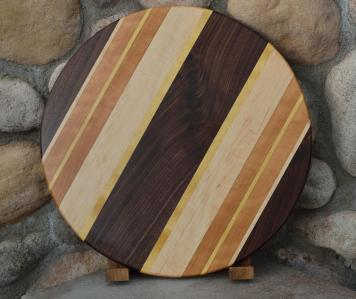 "Lazy Susan # 15 - 025. Black Walnut, Hard Maple, Cherry & Yellowheart. 17"" diameter x 3/4""."