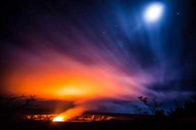 "Can you believe this picture from Hawai'i Volcanoes National Park? As water runs into the Halemaʻumaʻu Crater, intense heat from the lava pool quickly turns it into steam, offering a canvas for flames and moonlight to color. It's an extraordinary sight in a place of natural wonder and cultural importance. The crater's name translates into ""house of eternal flame"" and it is known as the home of the goddess Pele, the creator of new land. Photo by Eric Leifer. Tweeted by the US Department of the Interior, 10/3/15."