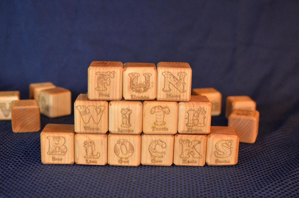 "37 Building Blocks. Hard Maple. 1.75"" x 1.75"" x 1.75""."
