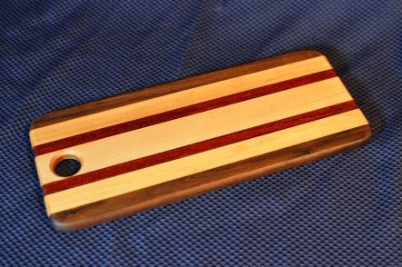 "Bread Board # 11. Black Walnut, Hard Maple & Padauk. 5"" x 15"" x 3/4"". Sold at its first showing."