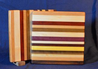 """Cheese Board # 15 - 048. Cherry, Hard Maple, Jatoba, Honey Locust, Jatoba, Purpleheart, Black Walnut & Yellowheart. 9"""" x 11"""" x 3/4""""."""