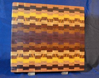 "Cutting Board # 15 - 081. Cherry, Bloodwood, Canarywood, Yellowheart, Padauk, Hard Maple, Jatoba & Purpleheart. 15"" x 18"" x 1-1/2""."