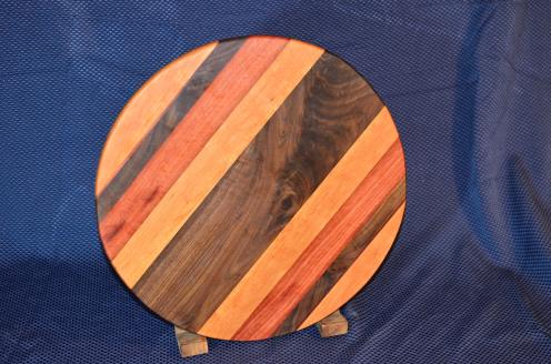 "Lazy Suan 15 - 033. Cherry, Black Walnut, Jarrah ... and the center piece of Black Walnut is quilted. 17"" diameter x 3/4"""