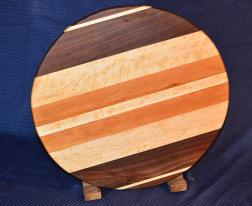 "Lazy Susan # 15 - 034. Black Walnut, Hard Maple, Birdseye Maple and Cherry. 17"" diameter x 3/4""."