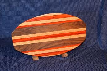 """Surfboard # 15 - 29. Red Oak, Padauk & Black Walnut. 12"""" x 19"""" x 1-1/4""""."""